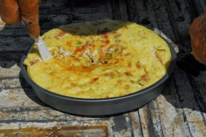 Kinford cutting cooked dutch oven omelet